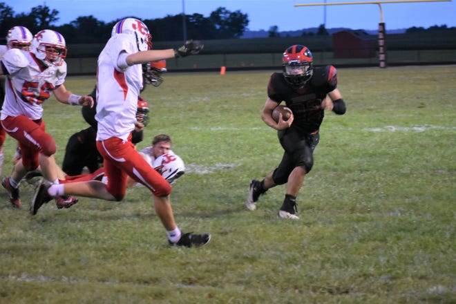 Blackford's Austen Lancaster carries the ball against Jay County in the first game of the season.