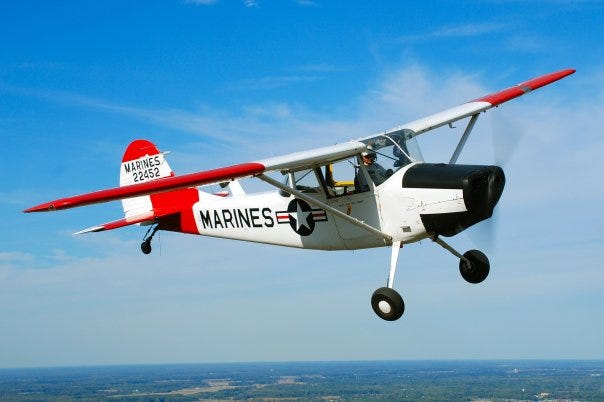 Bill Finney flies his Cessna L-19 Bird Dog above Jefferson County, Ind., near Lee Bottom airport.