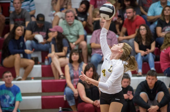 Cowan's Alexis Huff, shown here earlier this season against Wapahani, had 20 kills in the sectional championship Saturday against Wes-Del.