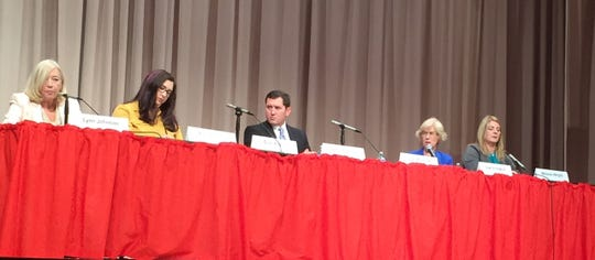 Democrats running for Indiana House seats (from left) Lynn Johnson, Amie Neiling, Shon Byrum, Sue Errington and Melanie Wright, take part in a public forum Oct. 3, 2018, at Northside Middle School.