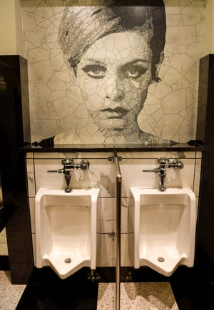 The mens room at the Sinema Restaurant and Bar is fashioned after an old Hollywood dressing room in Nashville.