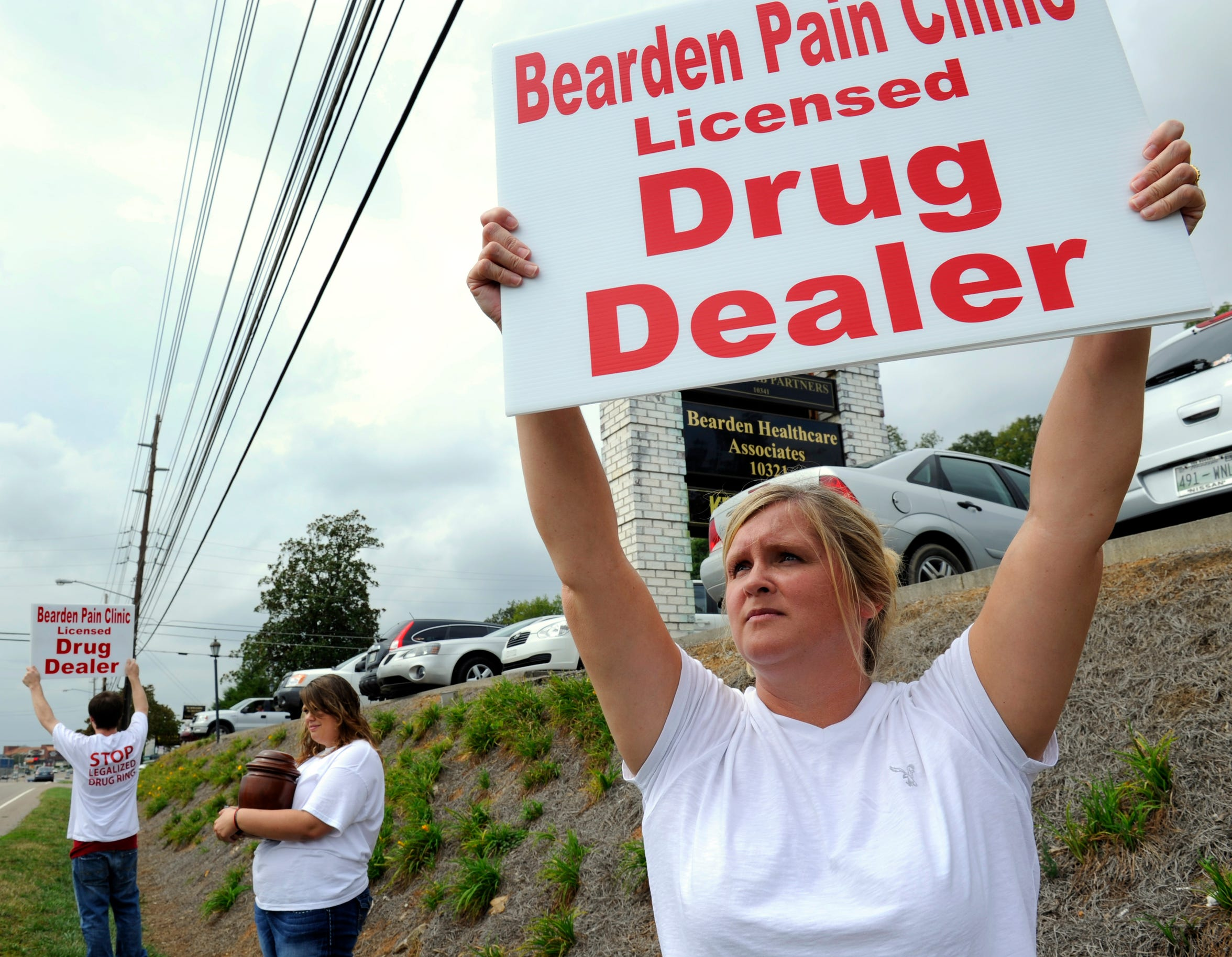 Stephanie Hines protests with family members outside the Bearden clinic Sept. 22, 2011. Hines said the clinic overprescribed pills to her husband, who died that year. The clinic is also where Christina Collins and others once prescribed painkillers by the handful.