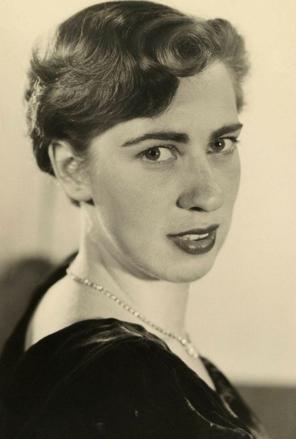 A young Eva Schloss is photographed after Auschwitz.