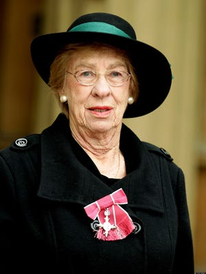 Eva Schloss, step-sister of World War II diarist Anne Frank, with her Member of the British Empire (MBE) medal after it was presented to her by the Prince of Wales, at the Investiture Ceremony at Buckingham Palace, on February 14, 2012 in London, England.