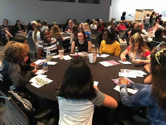 Girls from Lee County schools during group discussion with panelist, Nadege Borgat, Executive Director of The New Beginnings of SWFL, at the second annual L.E.A.D Like a Girl symposium held at Florida Southwestern State College on Thursday, October 4th.