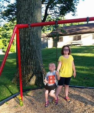 Matthew Offers with his sister Caroline Offers on June 24, 2016 at Hoback Park in Heath. Matthew loved to be outside and would swing at the playground at Hoback for hours. Matthew, who was born with a congenital heart defect, died Sept. 16, 2018.