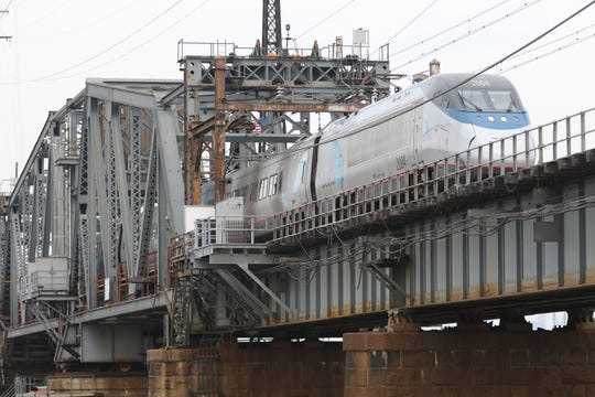 An Amtrak train goes over the current Portal Bridge, in Kearny, above the Hackensack River. Thursday, October 4, 2018