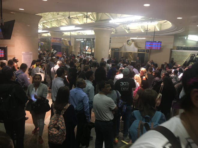 People waiting, likely impatiently, at New York Penn Station after a train derailment Oct. 4, 2018.