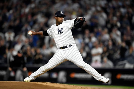 New York Yankees pitcher Luis Severino pitches to the Oakland Athletics in the first inning of the American League Wildcard game on Wednesday, Oct. 3, 2018, in New York.
