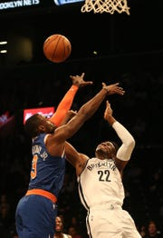 Oct 3, 2018; Brooklyn, NY, USA; Brooklyn Nets guard Caris LeVert (22) has his shot blocked by New York Knicks guard Tim Hardaway Jr. (3) during the first half of a preseason game at Barclays Center.
