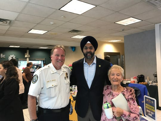 Garfield Chief Raymond Kovach, Attorney General Gurbir Grewal and resident Anne Sowa enjoy Coffee with a Cop