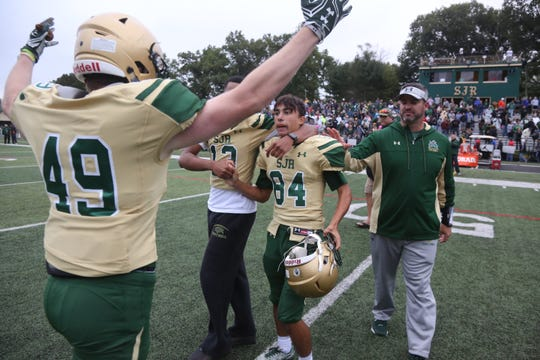 In 2016, Kevin Jaffe goes to hug kicker Angelo Guglielmello of St. Joseph's, who kicked the game winning field goal in OT.