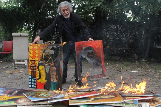 Artist Said Elatab, angered by the low turnout at his Paterson Museum exhibition, stacked about 20 of his paintings in his back yard last week and set fire to them. None of the works were part of the exhibit.