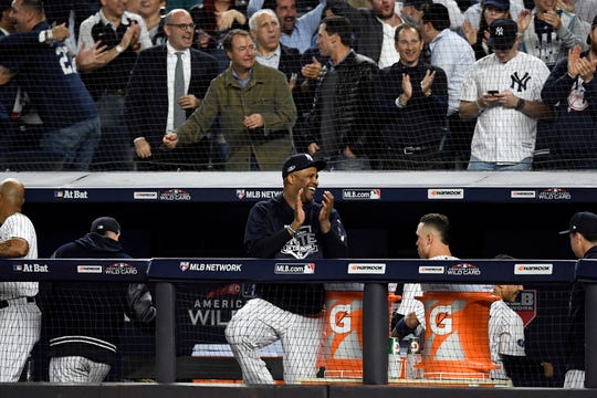 New York Yankees' CC Sabathia claps as Luke Voit (not pictured) scores in the sixth inning of the American League Wildcard game on Wednesday, Oct. 3, 2018, in New York.