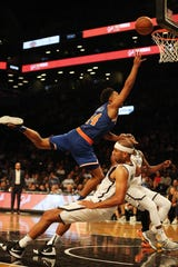 Oct 3, 2018; Brooklyn, NY, USA; New York Knicks guard Allonzo Trier (14) goes up for a shot while being fouled by Brooklyn Nets guard Spencer Dinwiddie (8) during the second half of a preseason game at Barclays Center.