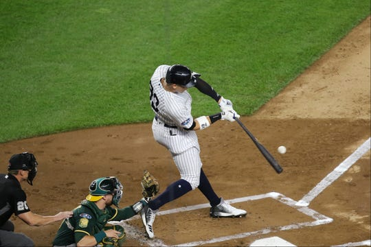 Aaron Judge hits a two-run home-run in the first inning to to put the Yankees on the scoreboard first.  Wednesday, October 3, 2018