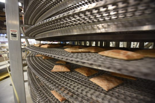 Pita breads are seen on the cooling conveyer at Toufayan Bakery in Ridgefield on 10/04/18. The Toufayan family is celebrating it's 50th year of doing business in New Jersey. The bakery is widely credited with popularizing pita bread in the U.S.