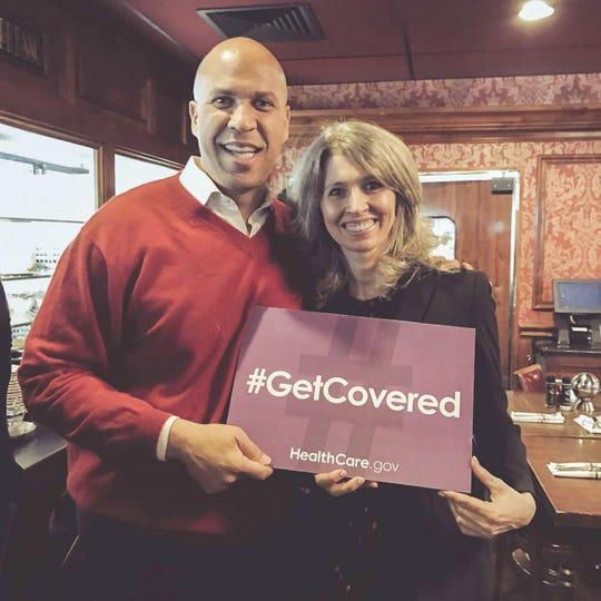New Jersey's Sen. Cory Booker stands with Montclair resident Chiara D'Agostino at an October 2018 event.