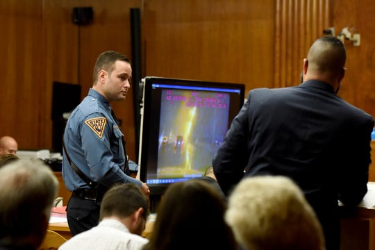 Jared Clackner, of Denville, is on trial in Bergen County Superior Court for killing his friend William Henning after a ZZ Top concert in 2015. Clackner is charged with aggravated manslaughter in the death of Henning. NJ State Trooper John Sousa answers questions from Bergen County Asst. Prosecutor Daryl Williams while testifying  on October 4, 2018. Sousa was one of the first to arrive on the scene on Rt 80W where Henning's deceased body was found in his car. A police video of the active scene is shown to jurors.