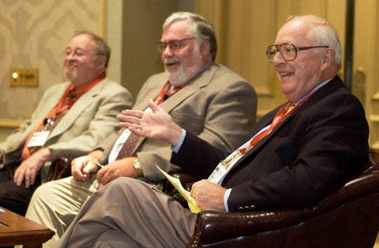 FILE - In this June 24, 2004, file photo, Dave Anderson, New York Times sports columnist, right, gestures while on a panel discussion with, from left, Jerry Izenberg, Newark Star-Ledger sports columnist, and Bill Conlin, Philadelphia Daily News sports columnist, while honoring the late Jimmy Cannon, New York Journal-American sports columnist, with the Red Smith Award during the Associated Press Sports Editors convention in Philadelphia. Anderson, a Pulitzer Prize-winning sports columnist, died Thursday, Oct. 4, 2018, at an assisted living facility in Cresskill, N.J., The New York Times said. He was 89.
