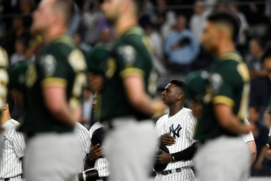 New York YankeesÕ Didi Gregorius stands for the National Anthem before facing the Oakland Athletics in the American League Wildcard game on Wednesday, Oct. 3, 2018, in New York.
