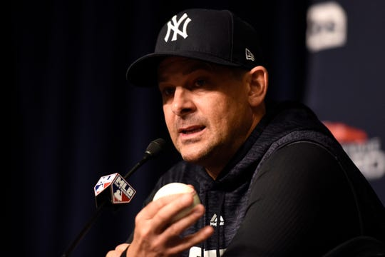 New York Yankees manager Aaron Boone answers a reporter's question during a press conference before the Yankees face the Oakland Athletics in the American League wild card game on Wednesday, Oct. 3, 2018, in New York.