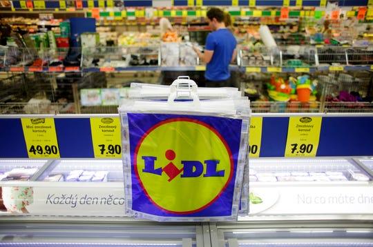 Freezer bags hang above a frozen food counter inside a Lidl discount supermarket store in Prague, Czech Republic,  June 13, 2013.