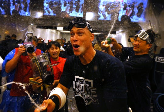 Oct 3, 2018; Bronx, NY, USA; New York Yankees right fielder Aaron Judge (99) celebrates after defeating the Oakland Athletics in the 2018 American League wild card playoff baseball game at Yankee Stadium.