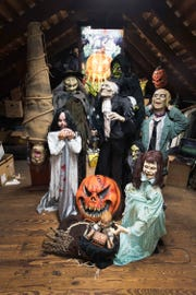"The animatronic ""family"" that lives in the attic of Robert Calderone and Dr. Joseph Amorino's Montclair home"