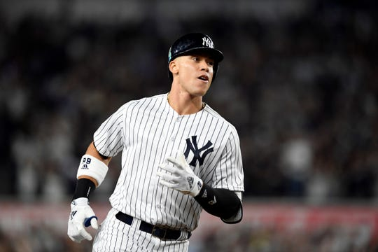 New York YankeesÕ Aaron Judge rounds third base after his two-run home run in the first inning against the Oakland Athletics in the American League Wildcard game on Wednesday, Oct. 3, 2018, in New York.