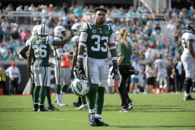 New York Jets strong safety Jamal Adams (33) looks at an official after being flagged for a penalty during the second half of an NFL football game against the Jacksonville Jaguars Sunday, Sept. 30, 2018, in Jacksonville, Fla. The Jaguars won 31-12. (AP Photo/Phelan M. Ebenhack)