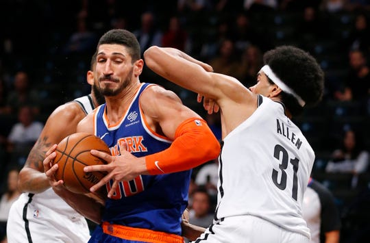 Brooklyn Nets center Jarrett Allen (31) defends against New York Knicks center Enes Kanter (00) during the second half of a preseason NBA basketball game Wednesday, Oct. 3, 2018, in New York. The Knicks won 107-102.
