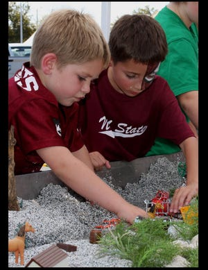 Young Aggie fans explore one of the many educational exhibits that will be available at AG Day Oct. 20. These interactive exhibits will provide hands-on activities for children and families and focus on the importance of agriculture in New Mexico.