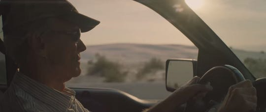 """In this screenshot from the trailer for """"The Mule,"""" Clint Eastwood is seen driving near White Sands National Monument."""