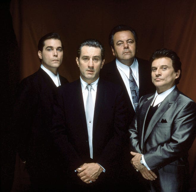 "Ray Liotta as Henry Hill, Robert De Niro as James Conway, Paul Sorvino as Paul Cicero, and Joe Pesci as Tommy DeVito in the movie ""Goodfellas."""