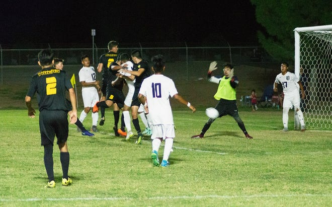 Alamogordo High School Tiger Rodolfo Junior Barbosa (2, with the orange shoes) sends the ball on its way to the back of the net after a corner kick that scored the final goal in the boys' soccer 3-1 win over the Deming Wildcats (3-10-1, 1-5) Tuesday. Tigers Daniel Ferenczhalmy (8) had one goal and one assist in the game while Keanu Tran (18) contributed one goal and two assists.  The Tigers (11-3, 4-2) host the Mayfield Trojans (9-3-1, 6-0) for a home conference game Saturday, Oct. 6, at 1 p.m.