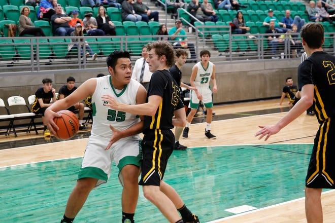 Farmington's Kobe Shorty looks to move the ball inside against St. Pius' Nik Skipp during a game on Jan. 13 at Scorpion Arena. FHS opens the new season at home against Valencia on Nov. 30.
