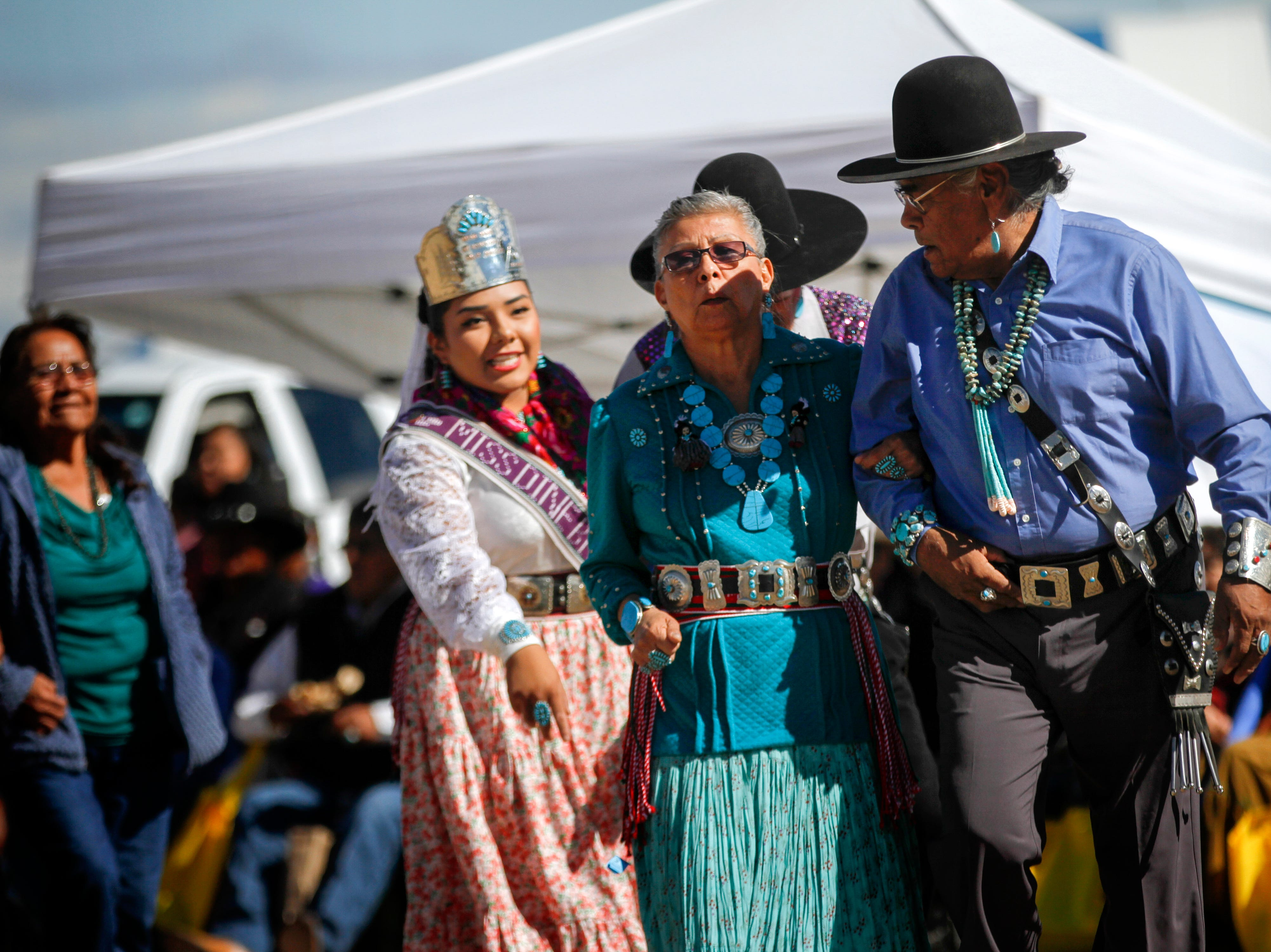 Participants dance in during the Elderfest Song and Dance activity, Thursday, Oct. 4, 2018 during the Northern Navajo Nation Fair at the Song and Dance Arena in Shiprock.