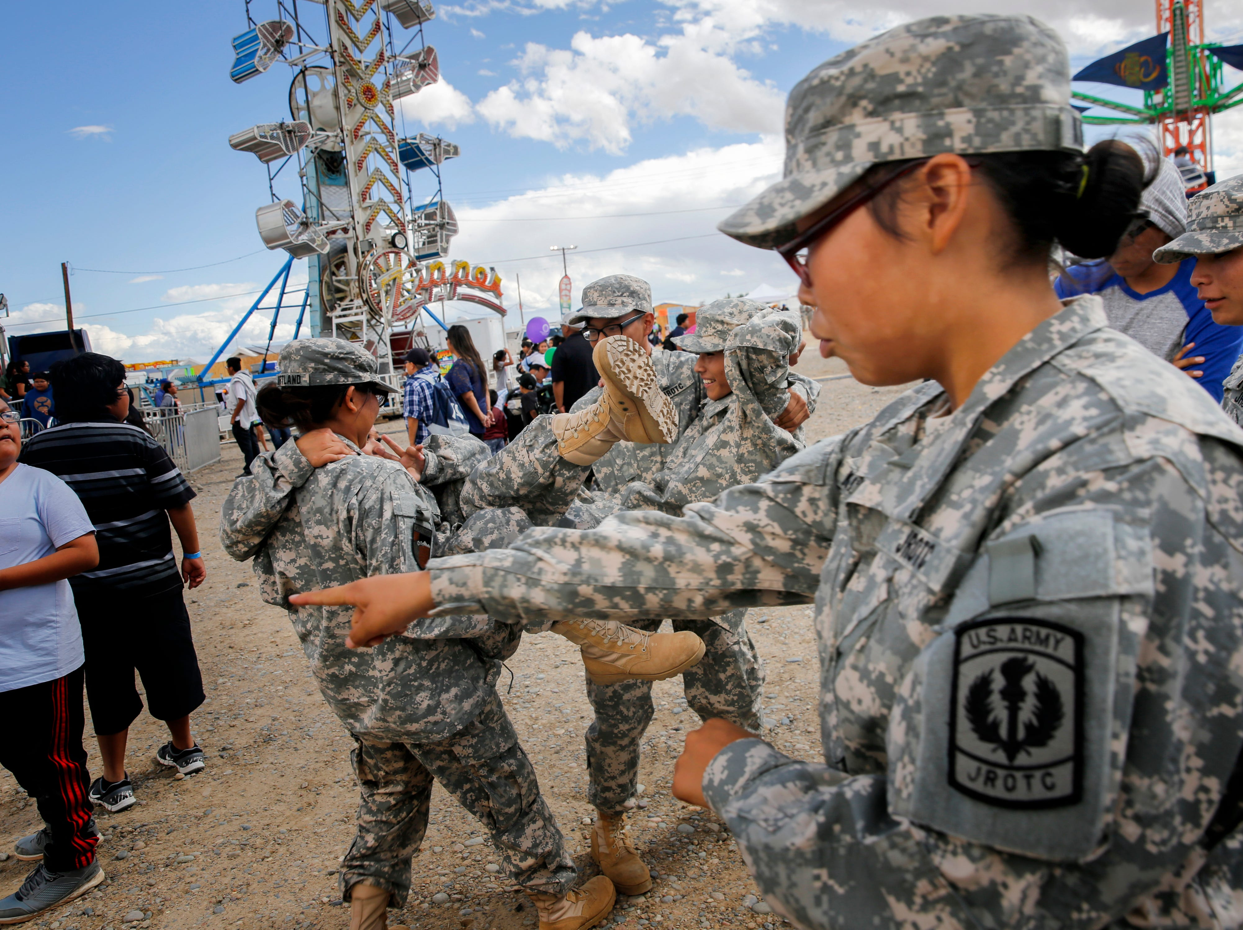 Members of the Kirtland Central High School JROTC members enjoy a day at the Northern Navajo Nation Fair, Thursday, Oct. 4, 2018 at the Northern Navajo Nation Fairgrounds in Shiprock.