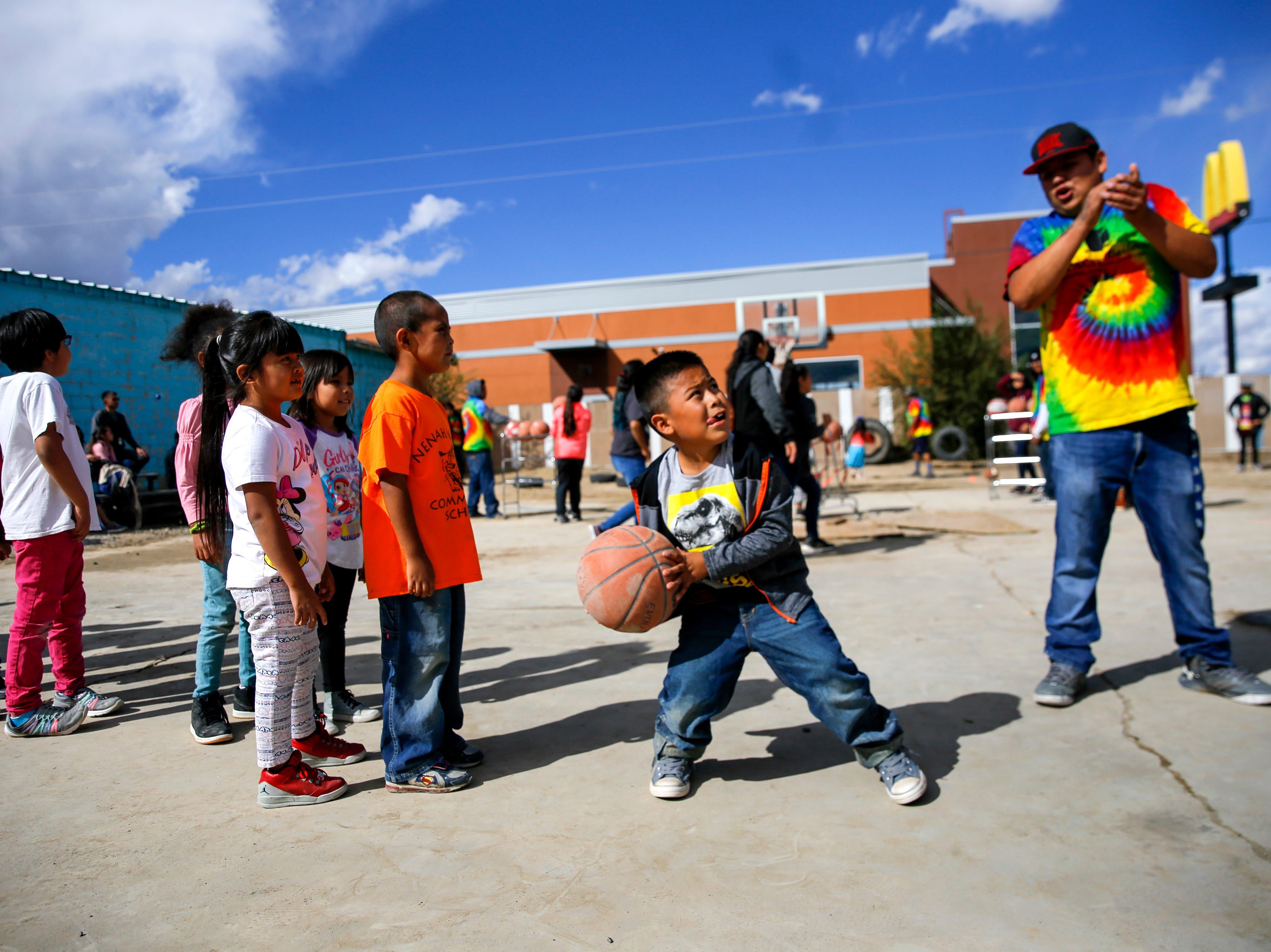 Children participate in a free throw contest, Thursday, Oct. 4, 2018 during the Northern Navajo Nation Fair in Shiprock.