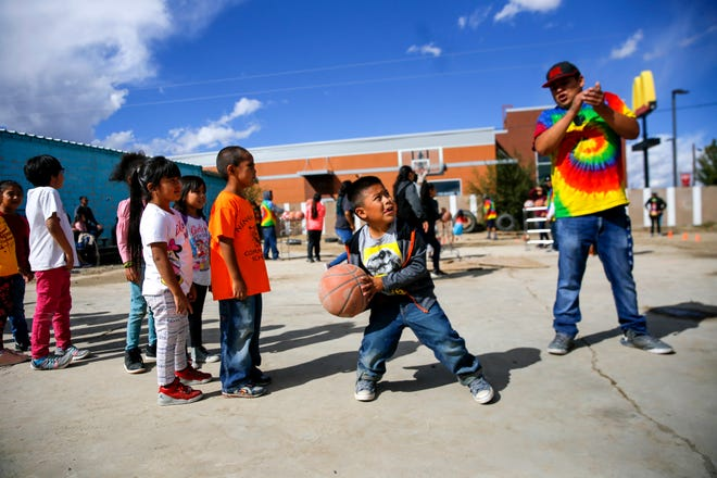 Children participate in a free throw shooting contest Thursday during the Northern Navajo Nation Fair in Shiprock.