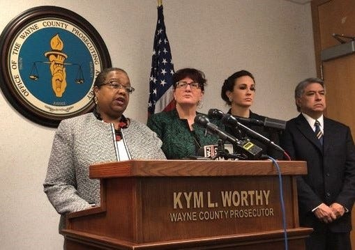 Wayne County Prosecutor Kym Worthy, with members of her staff, during an Oct. 1 press conference at which charges were announced against three people in the December death of William Marshall.
