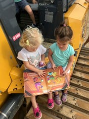 """The authors' daughters are captivated by """"Construction Cousins""""."""