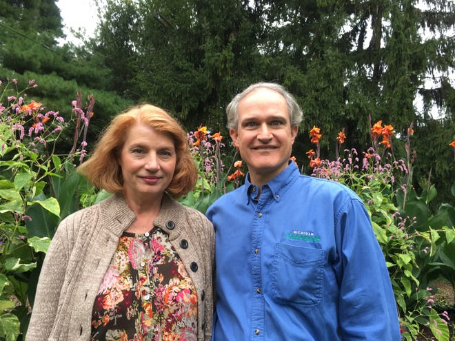 Expert gardeners Julia and Eric Hofley stand amidst the flowers in their beautiful one-acre Bloomfield Township garden. He is editor and owner of the Michigan Gardener publication. She is a writer and speaker on plant-related subjects.