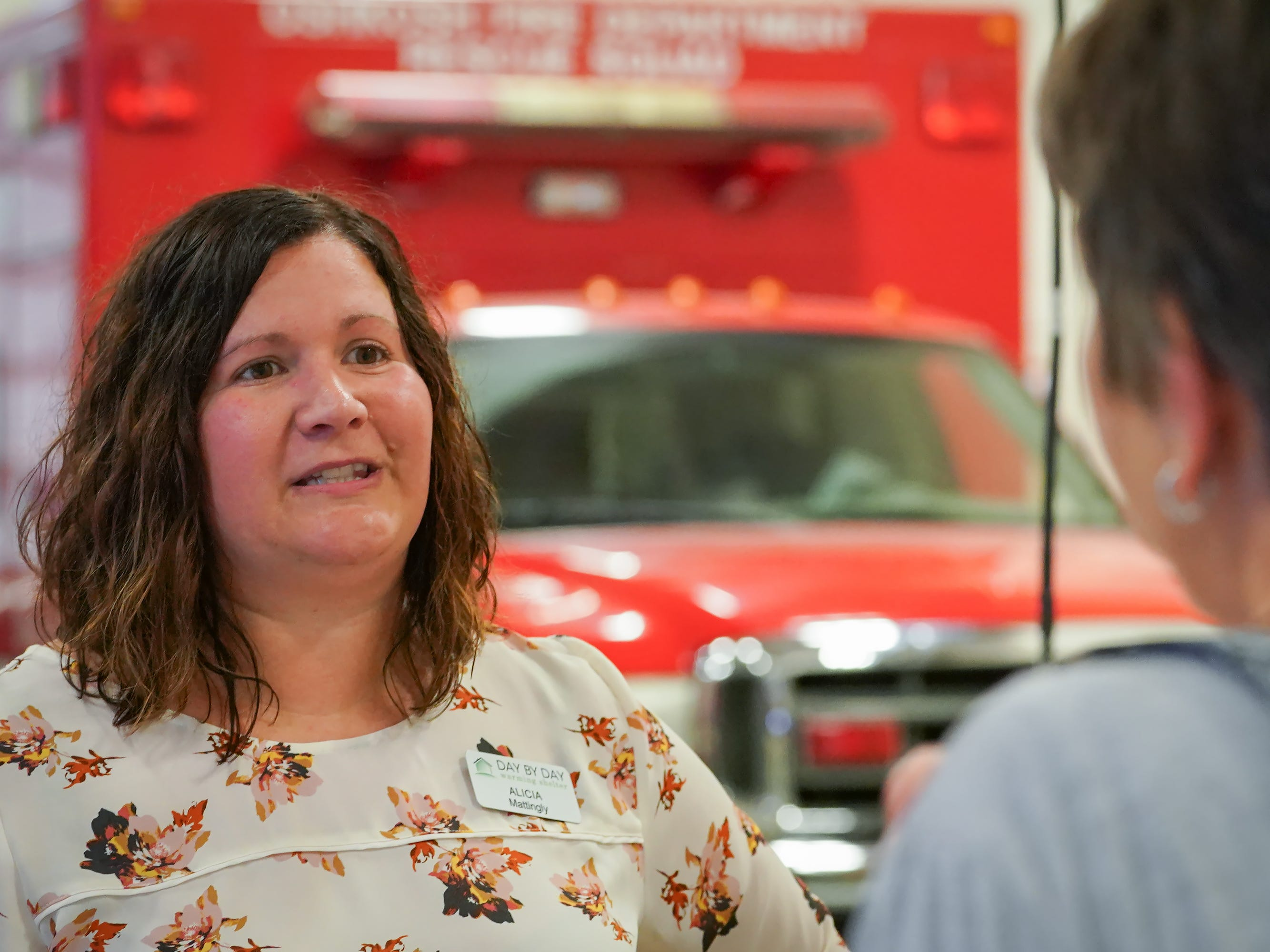 "Susan van Houwelingen talks with assistant shelter director Alicia Mattingly. The Oshkosh Day by Day Warming shelter teamed up with the Oshkosh Fire Department for ""Stuff the Shelter"" on Wednesday evening, October 3, 2018. Donations were accepted and fire station tours were given."