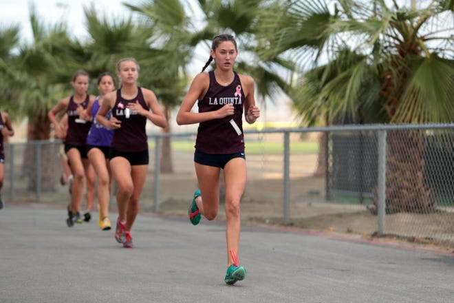 La Quinta's Emmi Von Scherr leads then wins the girls varsity race on Wednesday, October 3, 2018 during a Desert Empire League cross country race at Xavier Prep in Palm Desert.