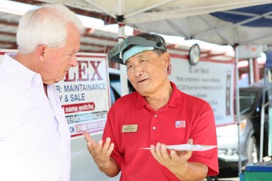 Republican gubernatorial candidate John Cox listens to Daniel Lee at The Street Fair at College of the Desert in Palm Desert on Sunday, September 30, 2018.