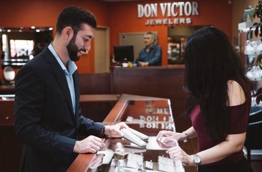 Daniel Cazares helps a Don Victor Jewelers client make a selection.