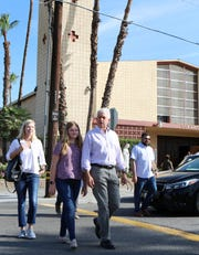 Republican gubernatorial candidate John Cox, his wife Sarah Cox and daughter Julianne Cox walk to his campaign bus after attending mass at Our Lady of Perpetual Help in Indio on Sunday, September 30, 2018.