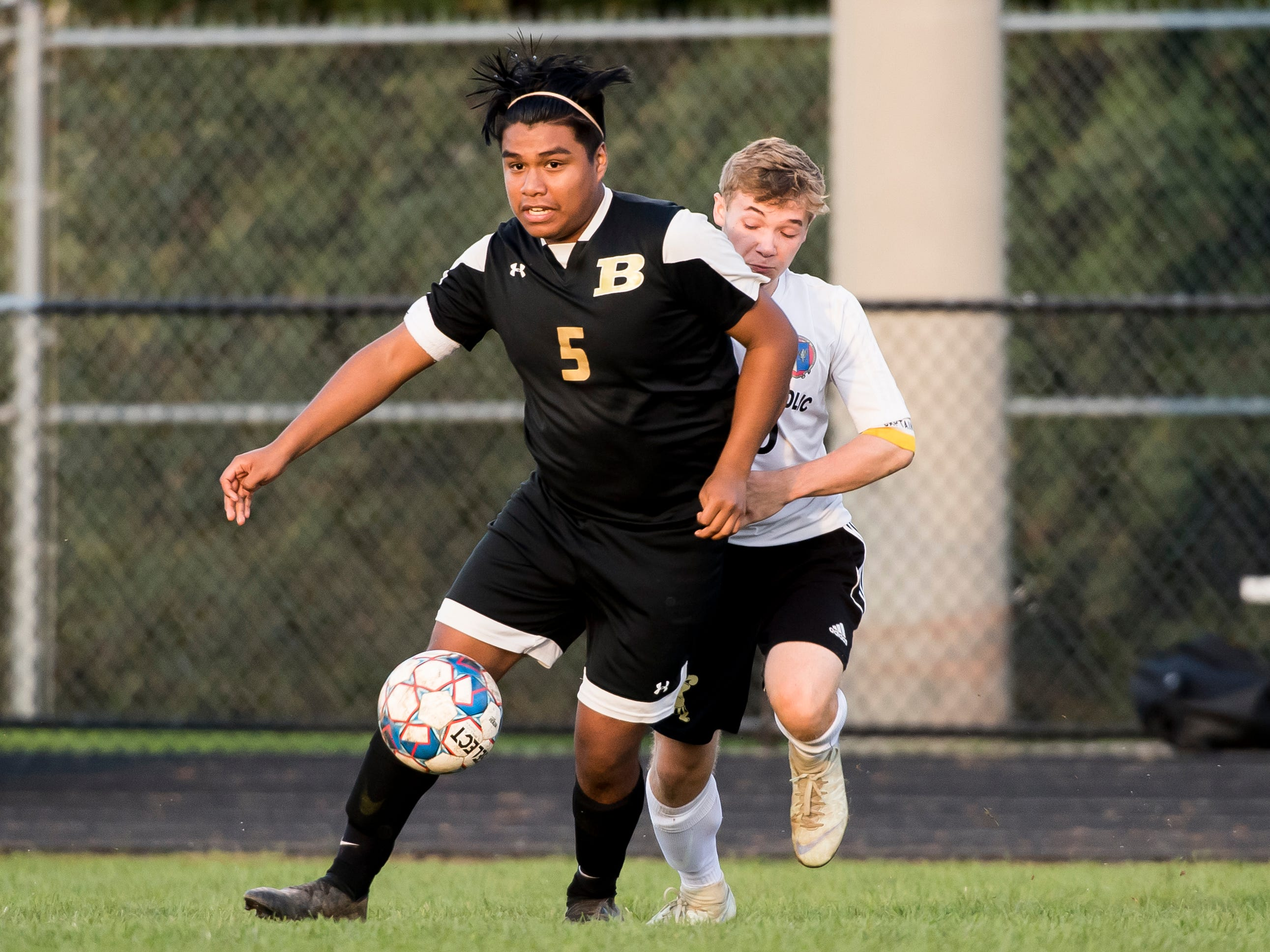 Biglerville's Christian Morales (5) defends against Delone Catholic's Noah Roeder on Wednesday, October 3, 2018. The Canners won 3-0.